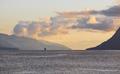 Norwegian fjord sunset landscape with cruise. Tourism Norway. Travel background