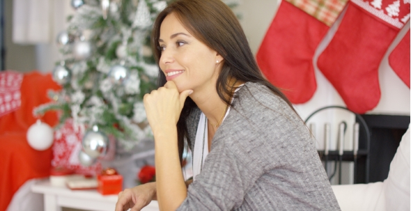 Cheerful Woman In a Festive Christmas Home