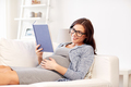 happy pregnant woman reading book at home