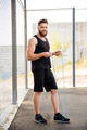 Happy bearded fitness man workout with jumping rope