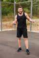 Full length portrait of a man workout with jumping rope