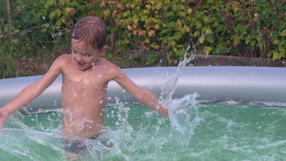 VideoHive Kid Plays At Basin In Sunny Day 18652890