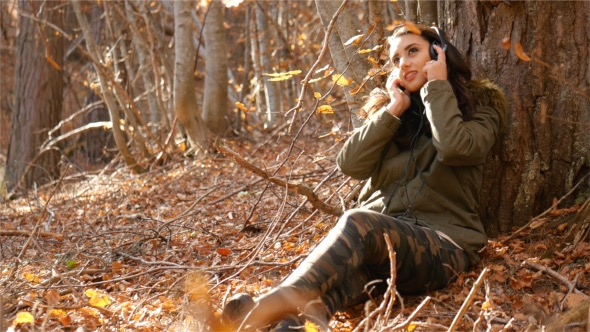 VideoHive Woman Listen to Music in the Woods 18654526