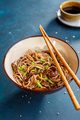 Buckwheat soba noodles with beef and sesame.