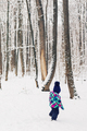 Two years old girl enjoy her first time snow experience