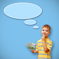 Child holding money and thought bubble on blue background
