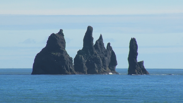 VideoHive Reynisdrangar Basalt Sea Stacks In Southern Coast Of Iceland In Sunny Day With Calm Blue Ocean 18675284
