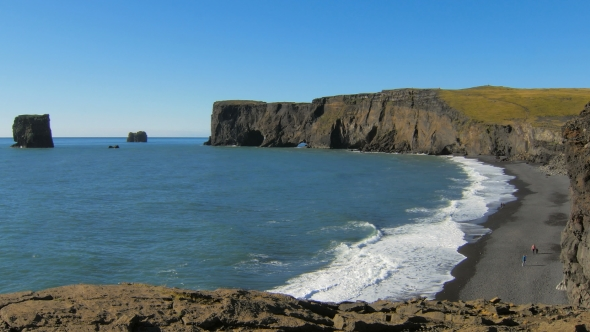 VideoHive Cape Dyrholaey And Black Sand Beach With Strolling Tourists And Blue Waves 18675355