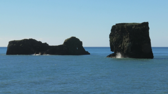 VideoHive Basalt Rocks On a Middle Of Ocean In Sunny Day Flocks Of Birds Flying Around 18675357