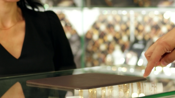 VideoHive Jewelry Shop a Pair Of Wedding Rings In Storefront Seller Consultant Demonstrates Rings Customer 18677985