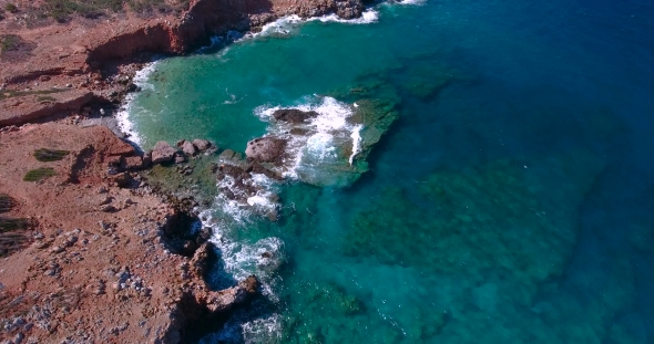 VideoHive Blue Sea Waves Breaking In Cliffs At Shore 18681794