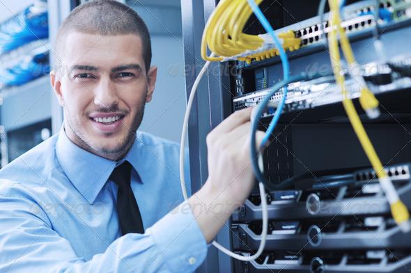 PhotoDune young it engineer in datacenter server room 1838929