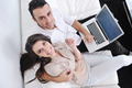 joyful couple relax and work on laptop computer at modern home - PhotoDune Item for Sale