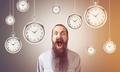 Shouting man and hanging clocks, toned