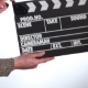 Male Hand Holding Movie Clapperboard