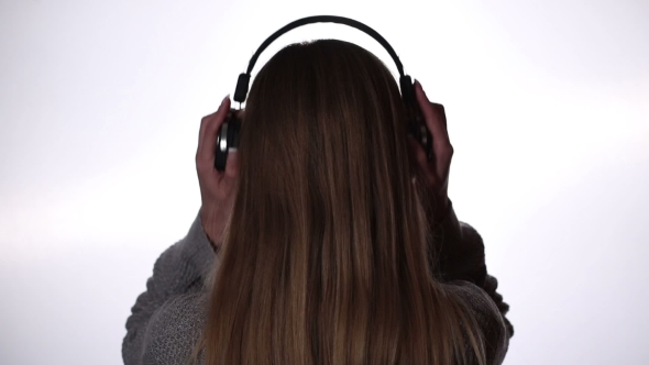 VideoHive Back View Of Woman Listening Music In Headphones 18688355