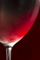Wineglass with cold red wine
