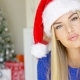 Cute Young Woman With Santa Claus Hat