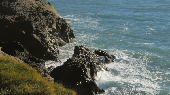 VideoHive Beautiful Blue Waves Of Atlantic Ocean Are Breaking Of Black Basalt Cliffs In Sunny Day 18699284