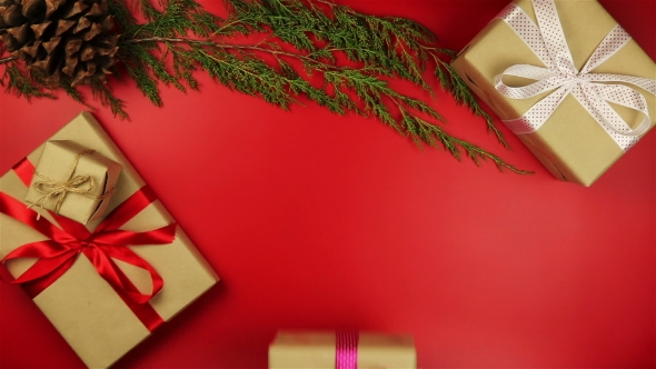 VideoHive Holding Christmas Presents On Red Background 18701195