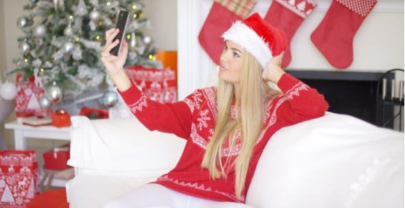Download Sexy Blond Girl In Christmas Outfin Taking a Selfie nulled download