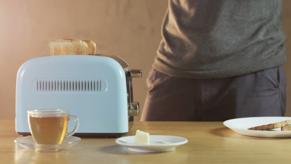 VideoHive Man Butters a Loaf Of Bread 18710000