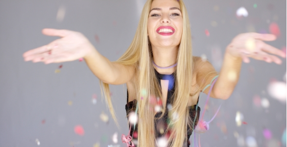 Download Sexy, Blond Girl Blowing Confetti To Camera Direction nulled download