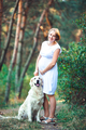 Beautiful pregnant woman and her dog