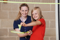 Teacher Giving Female Pupil Badminton Lesson
