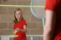 Two Girls Playing Badminton In School Gym