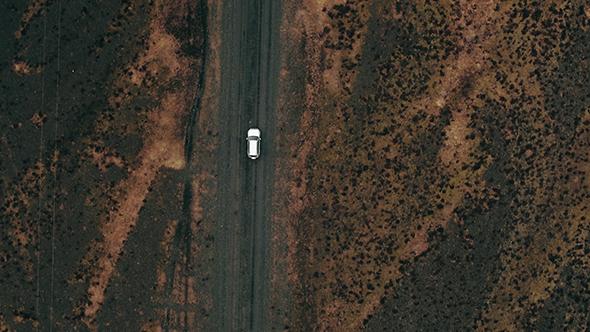 VideoHive Car Driving Along Dirt Road 18716322