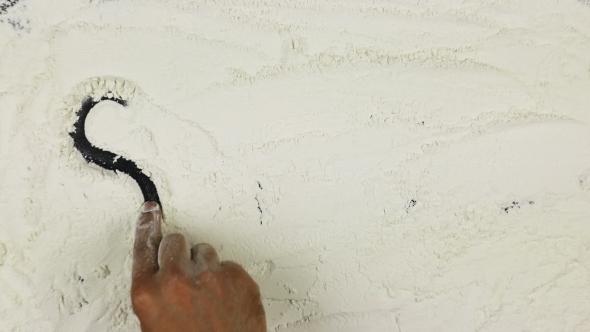 VideoHive Young Man Writes a Word Smile On White Flour 18718242