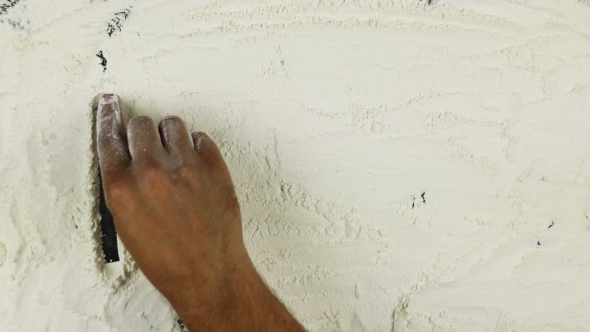 VideoHive Young Man Writes a Word Pizza On White Flour 18718248