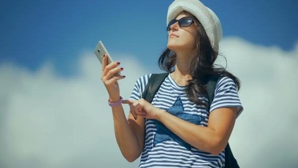 VideoHive Pretty Happy Woman Taking Selfie Photo With Smart Phone In The Mountains 18718338