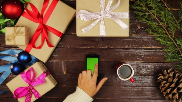 Christmas Hands Using Touchscreen Smartphone Tablet Christmas Presents Shopping List