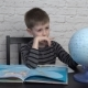 Little Boy Learning Geography