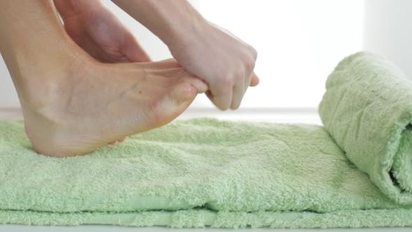 VideoHive Woman Applying Foot Cream 18722840