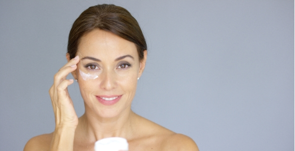 Download Beautiful Young Woman Applying Face Cream nulled download