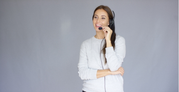 Download Adorable Call Center Agent Speaking With Someone On Headset nulled download