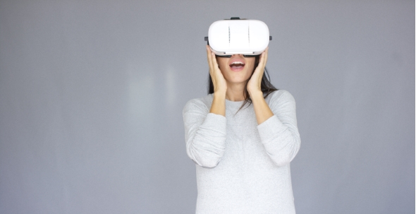 Download Excited Woman Watching Something On Her Virtual Reality Helmet nulled download