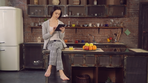 VideoHive Female With Modern Device Spends Morning In Flat 18726277