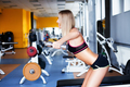 Girl exercising with dumbbells
