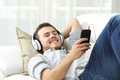 Happy man listening music at home