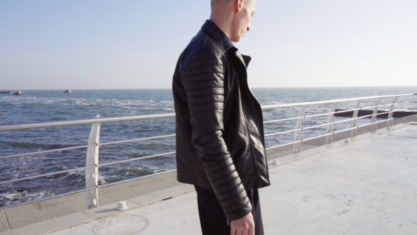 VideoHive Young Man In Black Leather Jacket Skating By The Sea 18735617