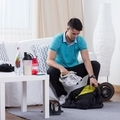 Man packing his sporting clothes