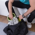 Man putting his kicks into a  bag