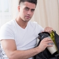 Man putting his diet cocktail into his bag