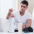 Man preparing his dietetic cocktail