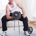 Man training on a gym with irons