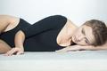 Sad woman wearing lying on the floor